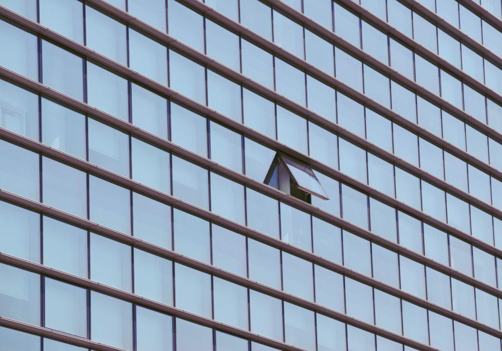 Skyscraper building with window open